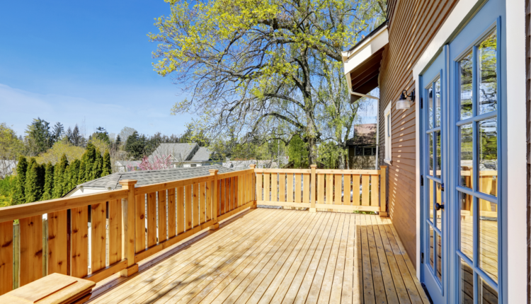 a beautiful patio with a wooden deck