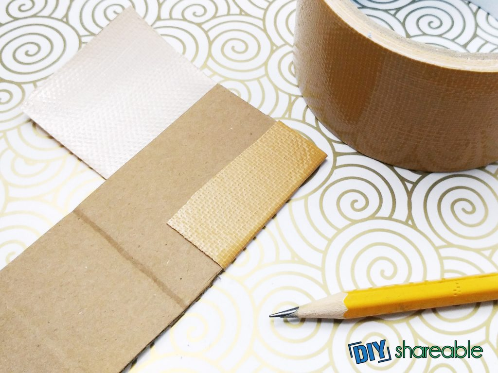 cut cardboard and tape for DIY bookmarks