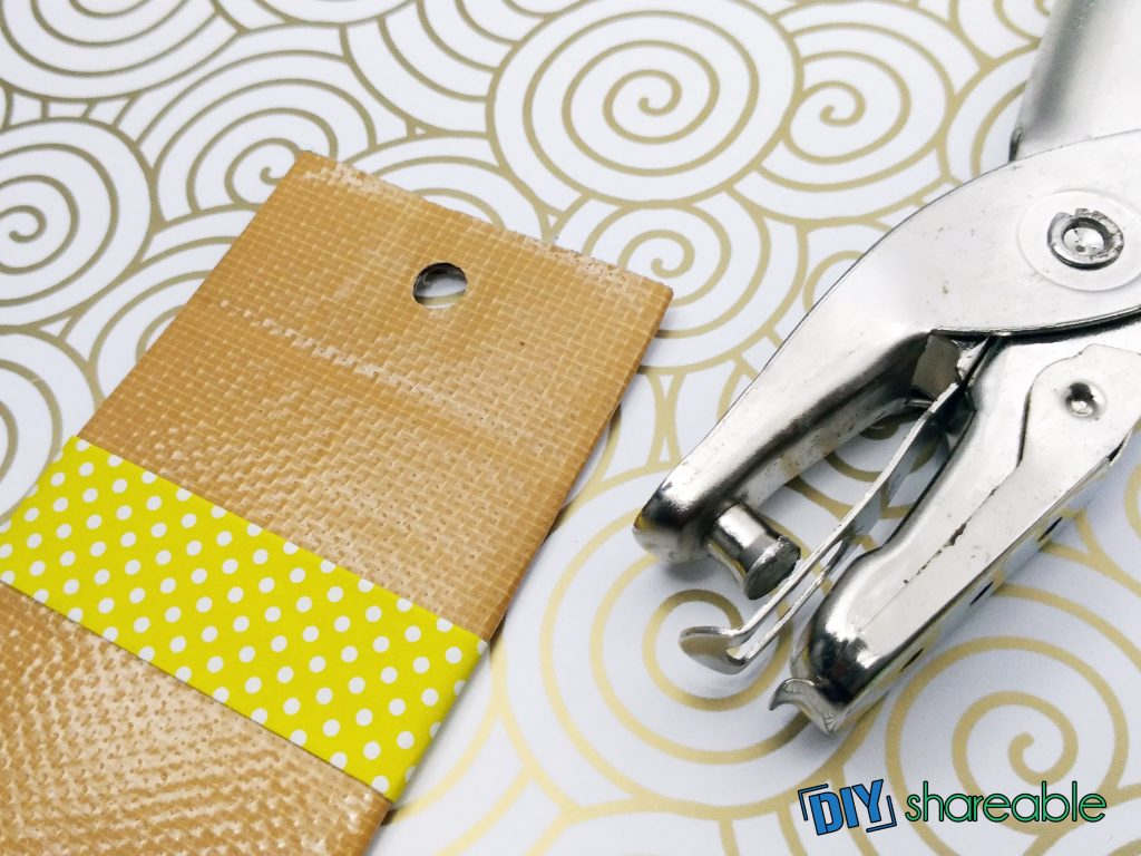 punch a hole to thread string through your DIY bookmark