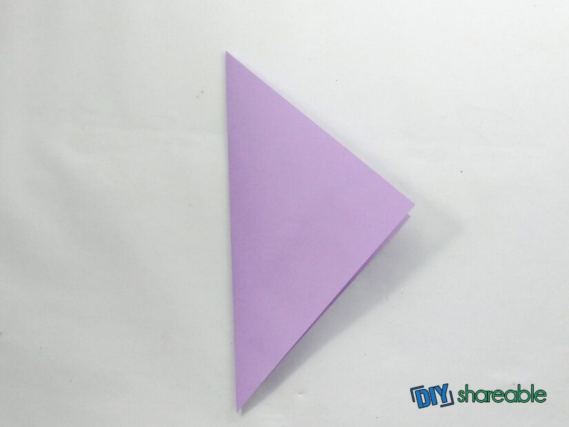 fold paper over to create the start of a bird