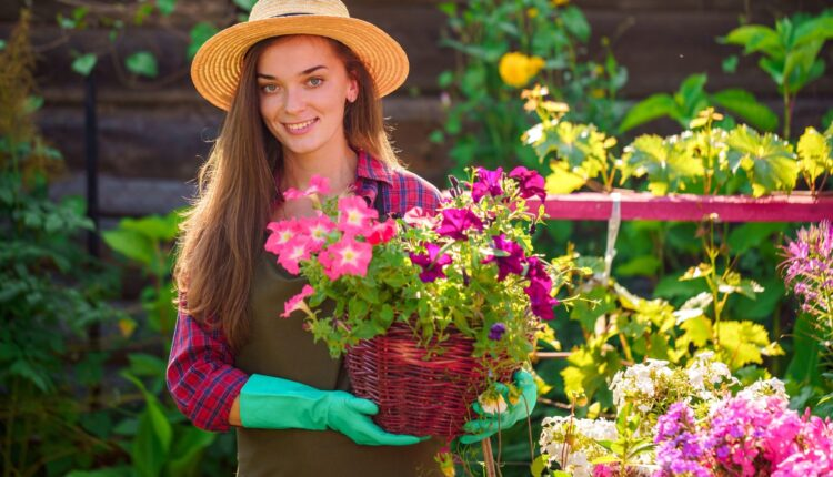 a woman holding a flower basket in the garden