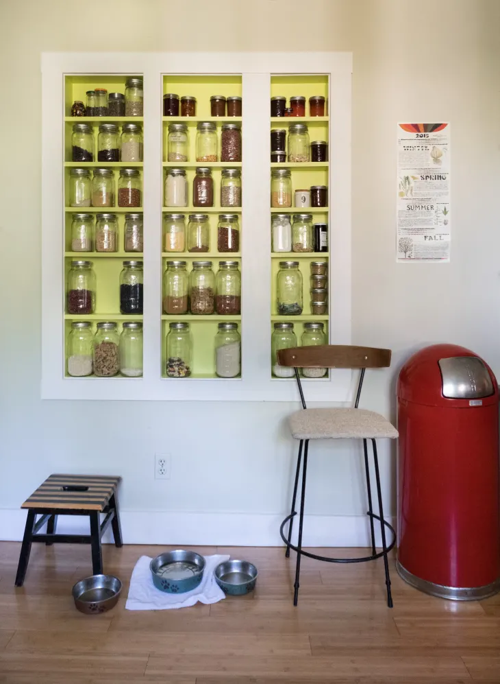 a jar rack in the wall