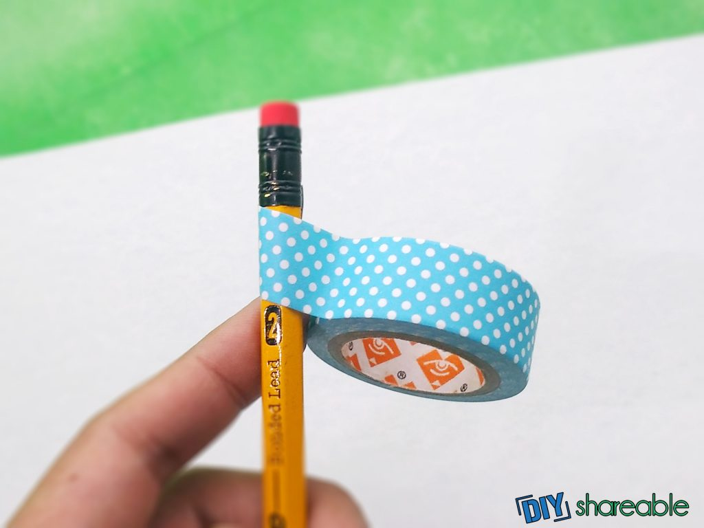 begin wrapping pencil at eraser end for diy personalized pencils