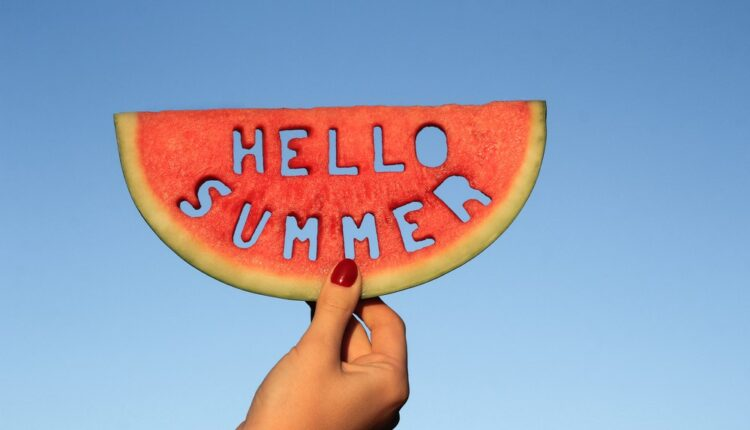 a watermelon with a hello summer carving on it