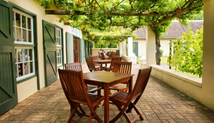 a wooden table and chairs outside