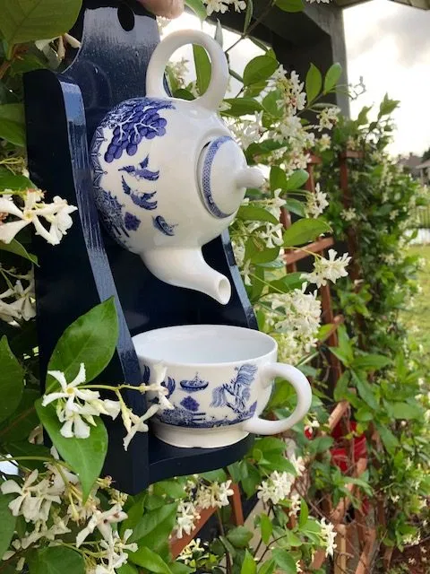 a white and blue tea cup