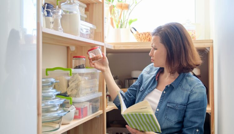 a photo of a woman organizing the kitchen rack