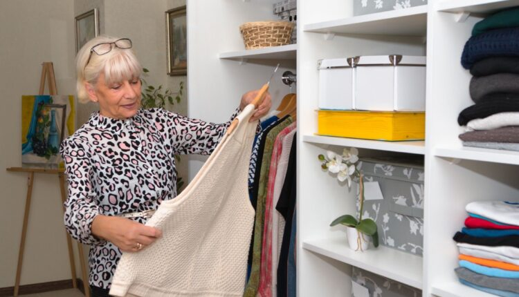 an old lady organizing some clothes