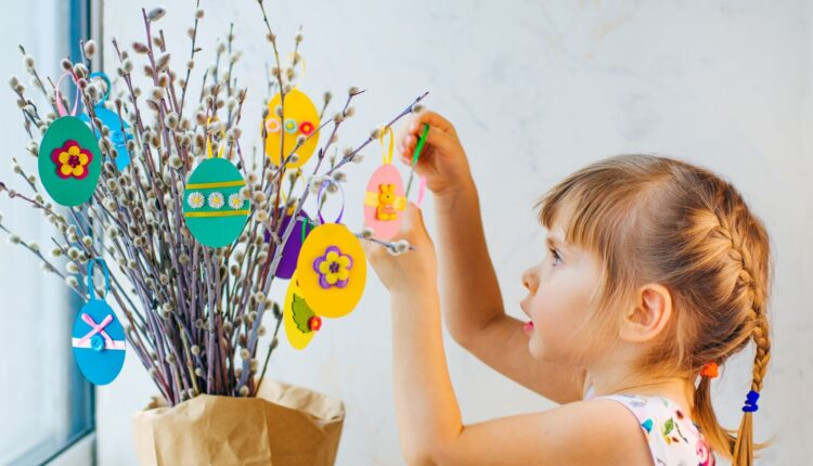 a young girl making a paper flower