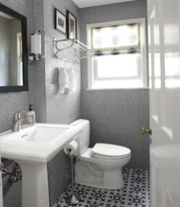 a clean white and gray bathroom