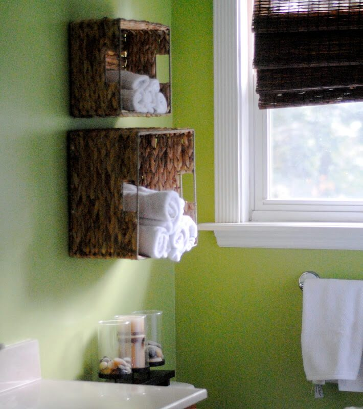 Inexpensive wicker basket shelves provide much needed storage space.