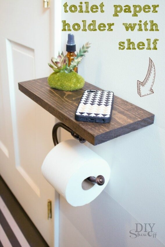 DIY toilet paper holder with stained wood shelf provides space.