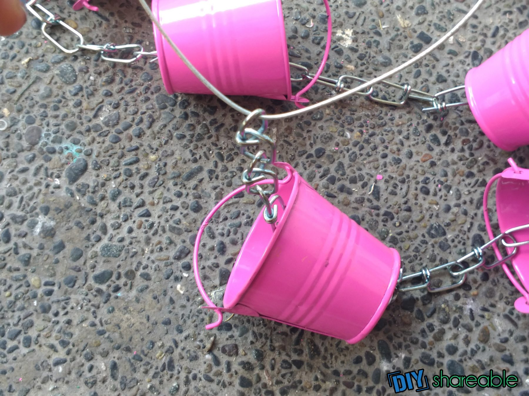 threading wire through the top of a DIY Rain Chain