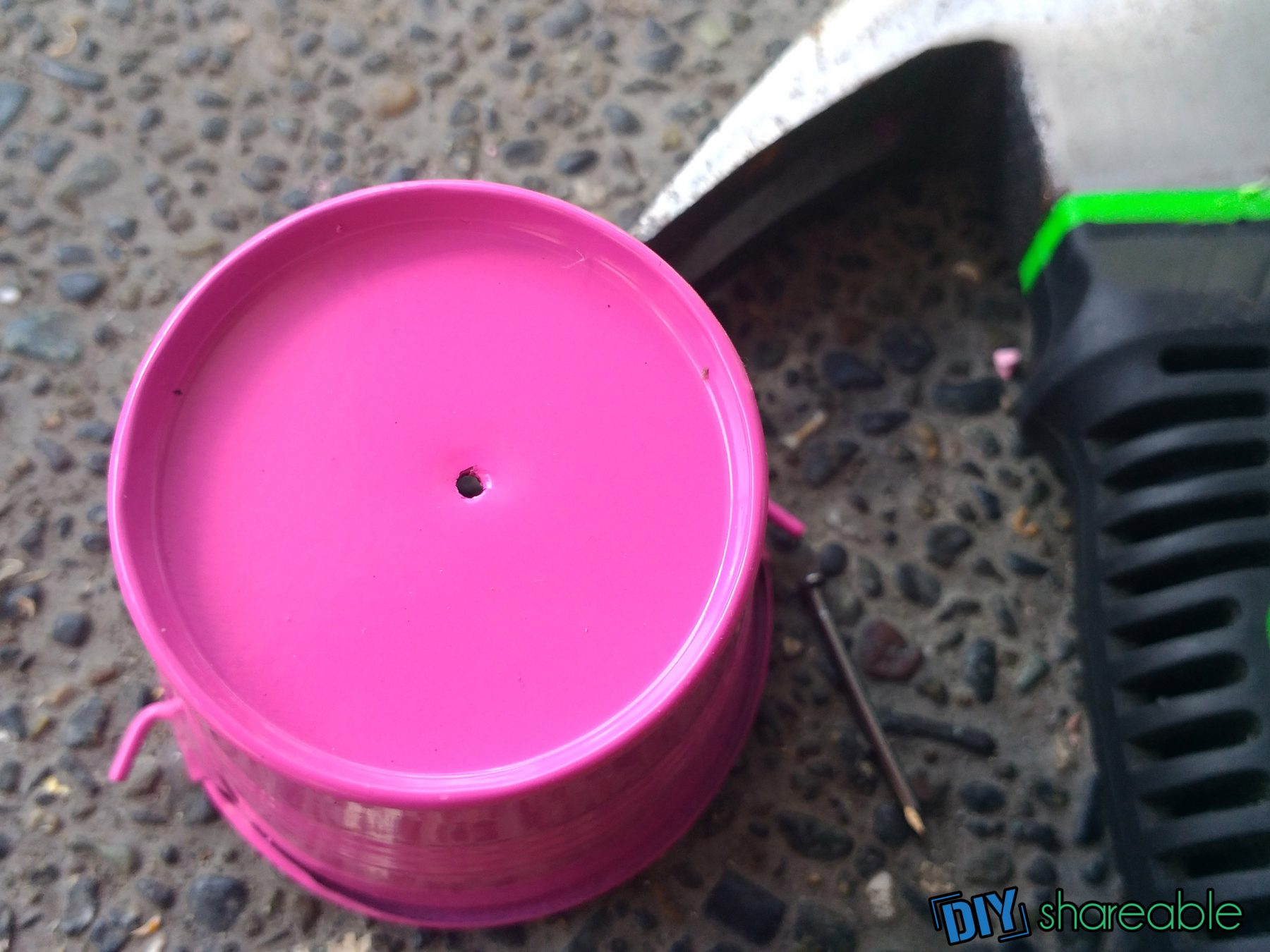 creating the hole for a DIY rain chain