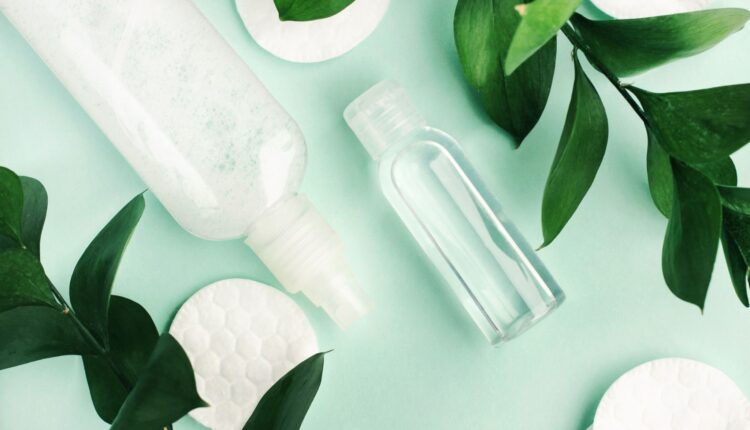 a photo of clear bottles with a background of leaves