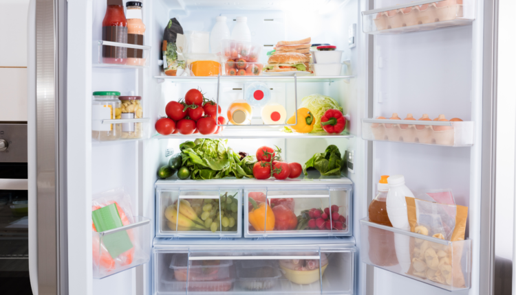 an organized refrigerator with full of fruits and stocks