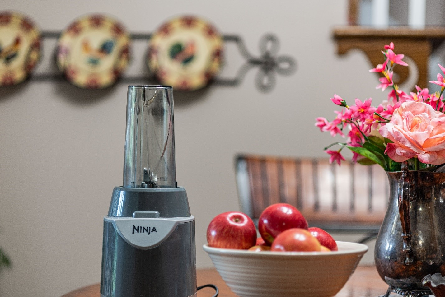 a Ninja blender with an apple on the side