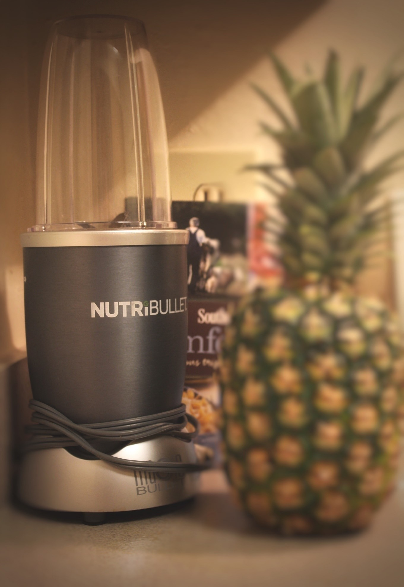 a Nutriblend blender with a pineapple on the side
