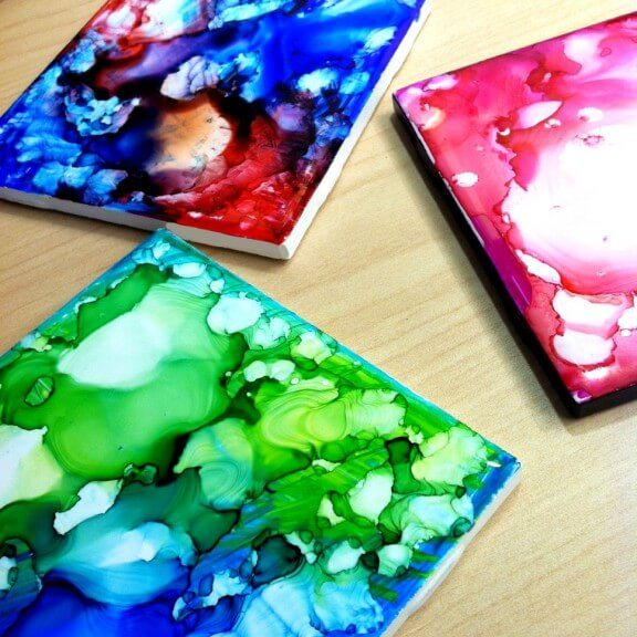 Craft coasters with colorful designs using sharpies and alcohol