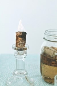 Wine cork candles in glass holder.