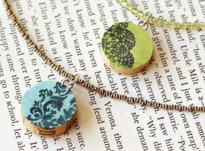 Colorful stamped pendants made from wine corks on necklaces.