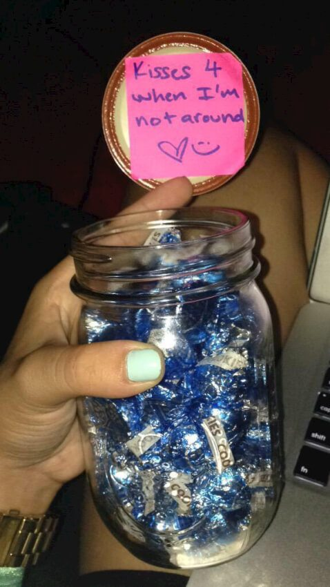 Jar of Hershey's kisses with a simple note to keep you on his mind.