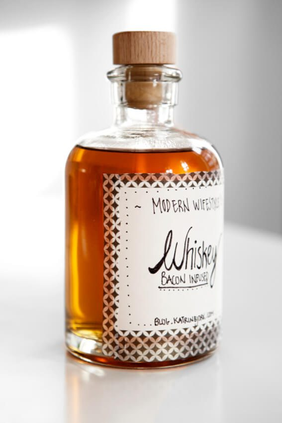 Whiskey infused with bacon provides a smoky flavor using a simple process.