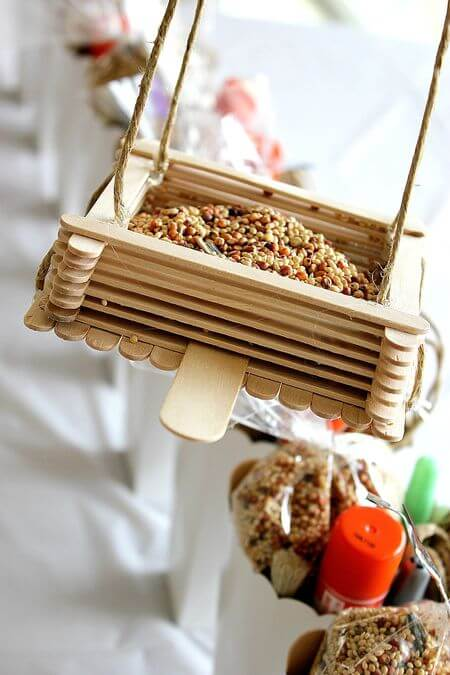 birdfeeder made from popsicle sticks and string