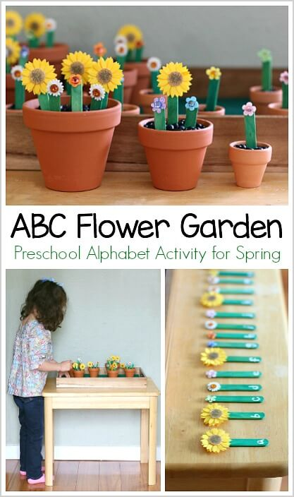 sticker and popsicle stick flower garden in terracotta small pots