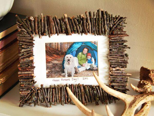 rustic twig picture frame with camping family and dog