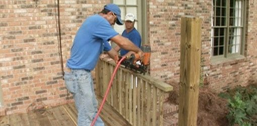 brown wooden deck railing mid-construction