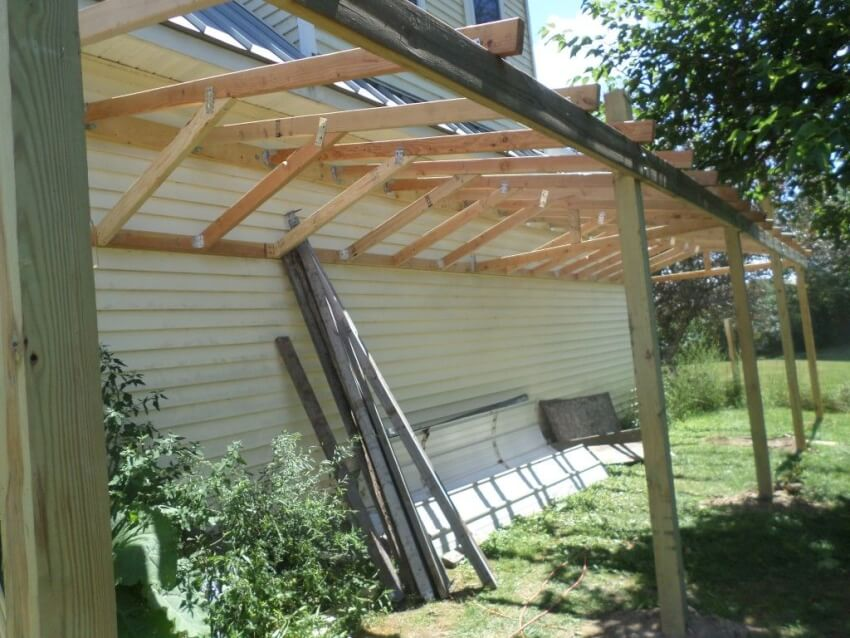 Attach the 2x4 roof joist supports between the lower stringer and the roof joists.