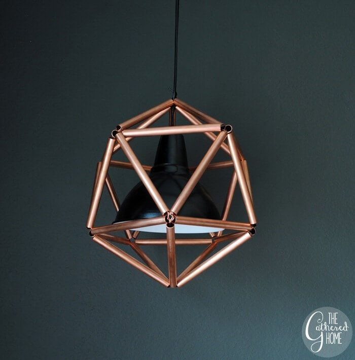 This stunning DIY light fixture is made of copper tubing but can also be painted to suit your look.