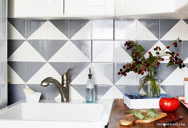 Create this eye-catching decorative backsplash using paint and an x-acto knife.