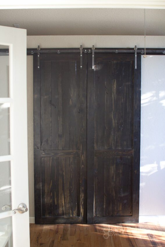 dark stained sliding barn doors with safety feautures