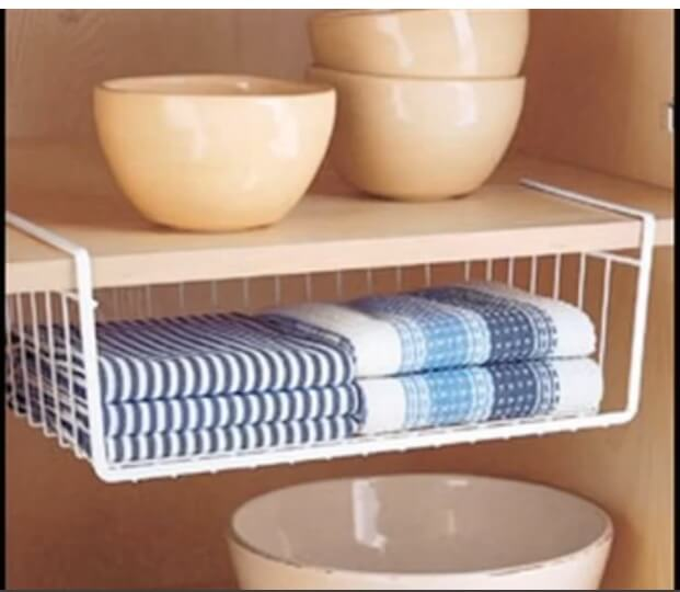 hanging shelf in kitchen towels and bowls