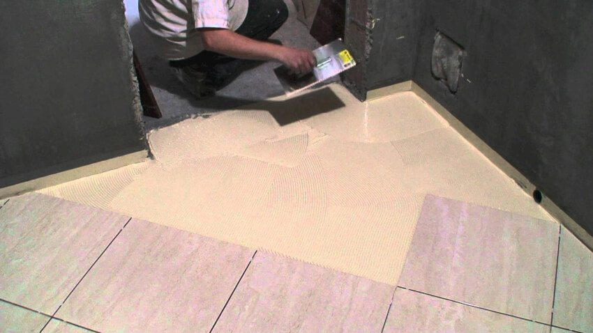 Installer laying tile on the diagonal