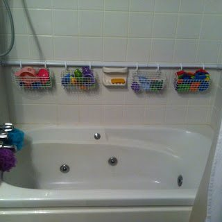 Plastic baskets and a shower rod can bring order to those unruly bath toys.