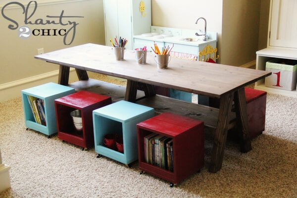 DIY double trestle Lego table with seating that stores books as well