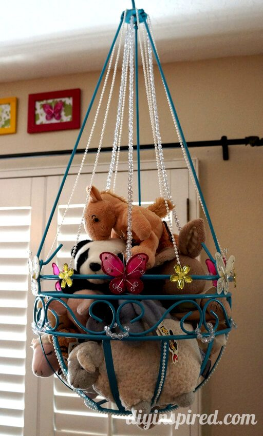 Use a stadard planter from a gardening store to store stuffed animals