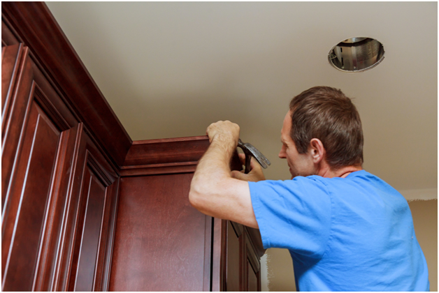 Man fixing the cabinet