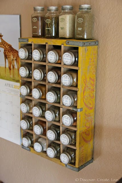 Vintage crates make for an easy way to store your favorite spices. Use mason jars so that all containers uniformly fit the holes.