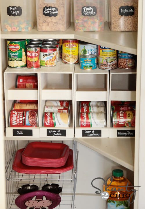"""These canned food organizers dispense your cans as needed and provide room on top for the """"one-off"""" cans you may have."""