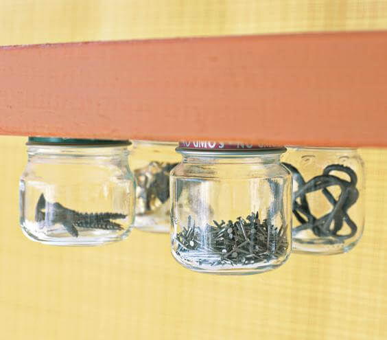 These undershelf storage jars can make the most of underutilized space. Store all kinds of things under shelves in your garage, kitchen cabinets, or closets.