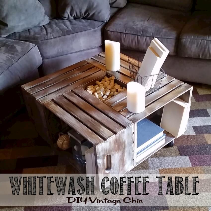 Very cool whitewash coffee table made from wooden crates. Creates a table surface with storage underneath as well as in the very middle of the table.