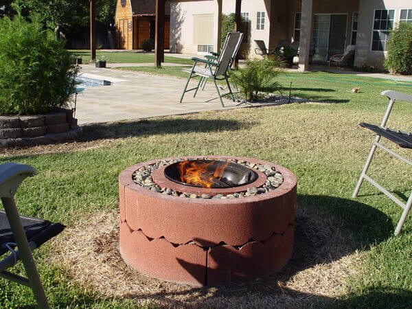 This DIY fire pit using concrete tree rings makes for a easy way to build a very functional yard feature.