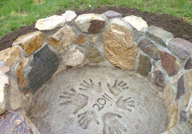 This in ground fire pit provides a low profile and even the opportunity to personalize with handprints while pouring the concrete.