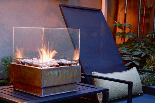 This beautiful glass box fire pit is not as hard as it looks and it is quite the eye-catcher.
