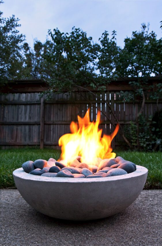 Create a majestic, mesmerizing feature for your backyard with this case concrete bowl fire pit.